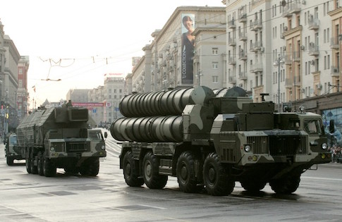 Russian military vehicles move along a central street during a rehearsal for a military parade in Moscow