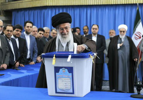 Supreme Leader Ayatollah Ali Khamenei casts his ballot during parliamentary and Experts Assembly elections / AP