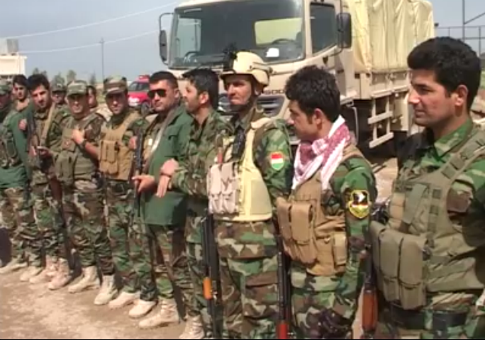 Kurdish fighters with boots donated by Americans
