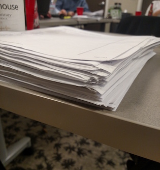 stack of paper exit polls
