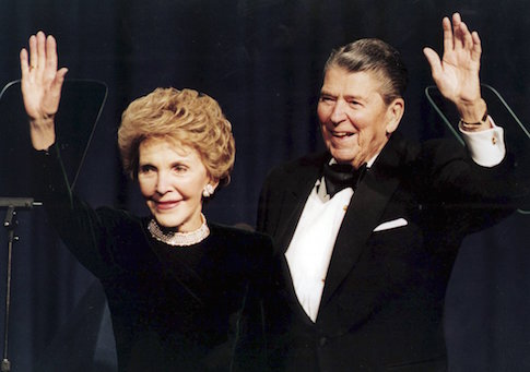 File photo of former U.S. President Ronald Reagan and his wife Nancy waving while attending a gala celebrating his 83rd birthday in Washington
