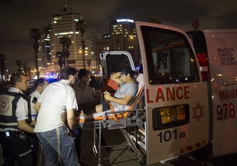 A wounded man is evacuated from the scene of a knife attack in Jaffa / AP