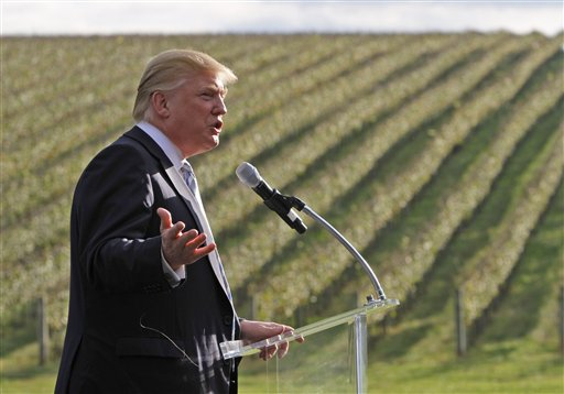 Donald Trump speaks at the site of Trump Winery in 2011 / AP