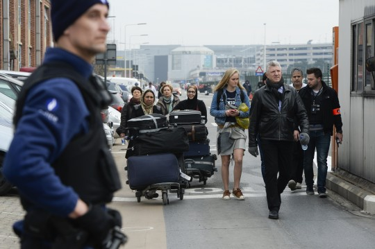 People are evacuated from Brussels Airport  / AP
