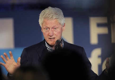 Bill Clinton at a Massachusetts rally for his wife / Christine Peterson/Worcester Telegram & Gazette via AP