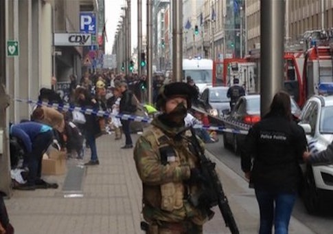 In this image taken from TV, emergency services attend to scene after explosion at subway station in Brussels / AP