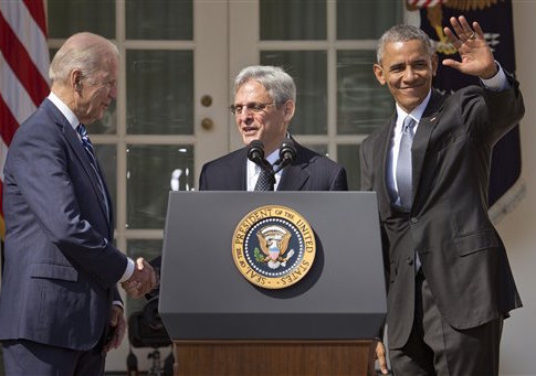 Merrick Garland with Joe Biden and Barack Obama / AP