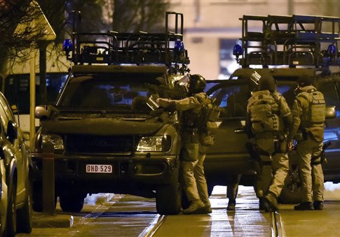 Police secure an area after an apartment raid in Brussels Tuesday / AP