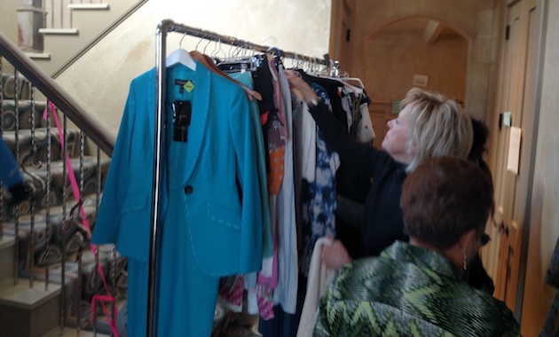 Ladies rummage through Wendy Davis' clothes / Brent Scher