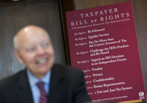 IRS Commissioner John Koskinen with the Taxpayer Bill of Rights / AP
