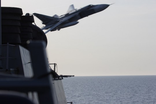 In this image released by the U.S. Navy, a Russian SU-24 jet makes a close-range and low altitude pass near the USS Donald Cook on Tuesday, April 12, 2016, in the Baltic Sea. / U.S. Navy via AP