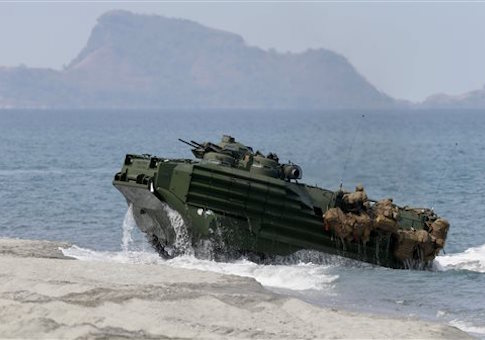 A U.S. Navy amphibious assault vehicle is seen on a beach facing Scarborough Shoal. / AP