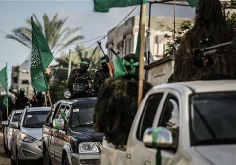 Palestinian Hamas militants take part in a rally / AP