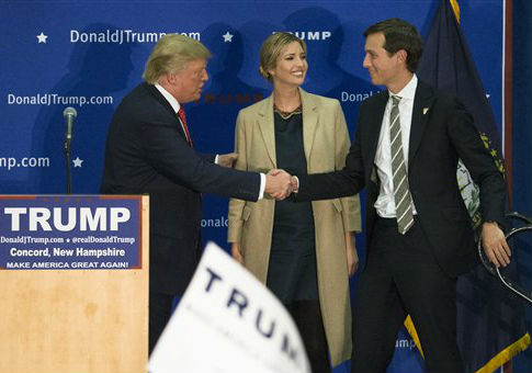 Donald Trump shakes the hand of adviser and son-in-law Jared Kushner / AP