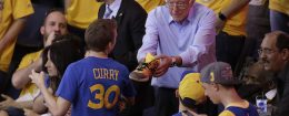 Democratic presidential candidate Bernie Sanders hands a guy a shoe / AP
