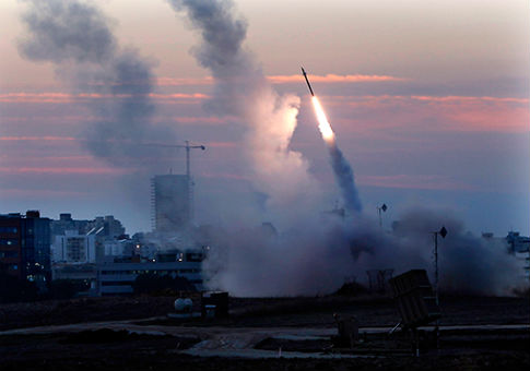 The Iron Dome system intercepts an incoming missiles from Gaza. / Reuters