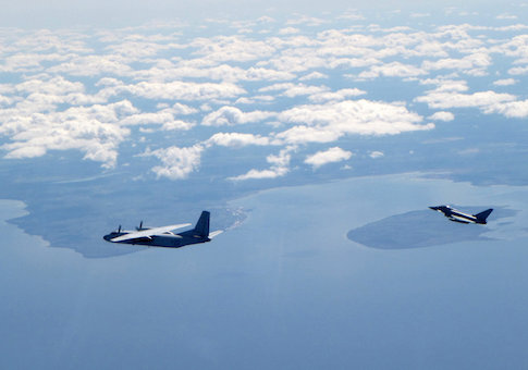 A Russian An26 Curl aircraft is shadowed by a RAF Typhoon (R) in this photograph handed out by the Royal Air force