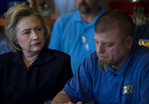 Hillary Clinton talks to steel workers and community leaders in Ashland, Ky. / AP