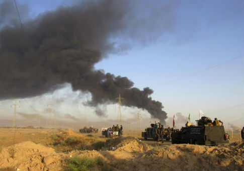 Smoke rises from Islamic State positions as Iraqi security forces and allies take combat positions outside Fallujah / AP