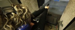 A woman discharges a handgun at a shooting range / AP