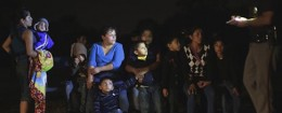 A group of  immigrants from Honduras and El Salvador who crossed the U.S.-Mexico border illegally are stopped / AP
