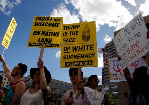 Protesters threw rocks and bottles at police officers who responded with pepper spray outside a rally for presidential candidate Donald Trump in Albuquerque, New Mexico, police said.
