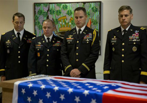 U.S. military officers stand around the coffin of Taylor Force, killed in a March 11 stabbing attack / AP
