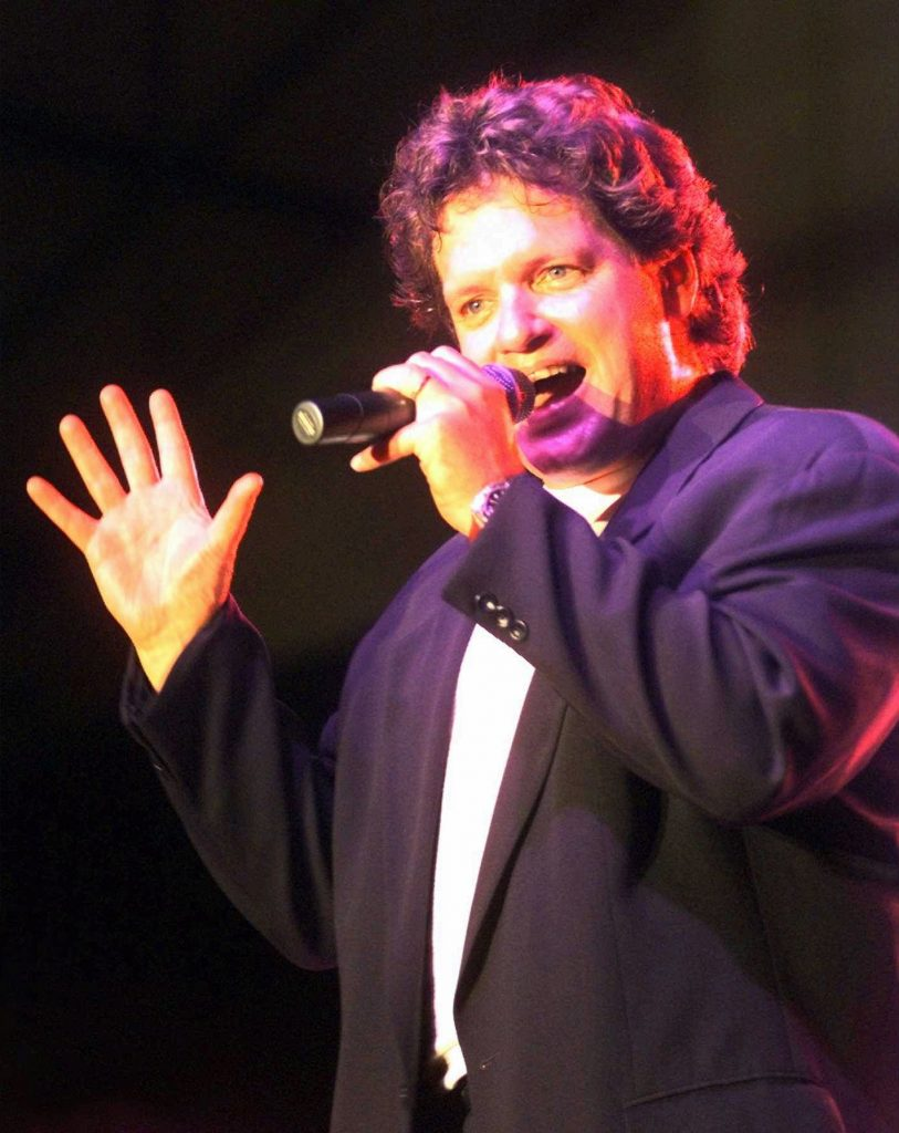 Roger Clinton, brother of President Clinton, sings with his band at the San Mateo Fair in San Mateo on Monday, Aug. 11, 1997 in San Mateo, Calif. (AP Photo/Susan Ragan)