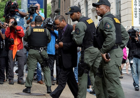 Officer Caesar Goodson arrives at the courthouse in Baltimore