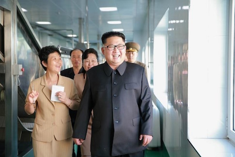 North Korean leader Kim Jong Un gives field guidance to the newly built Ryugyong Kimchi Factory in this undated photo released by North Korea's Korean Central News Agency (KCNA)