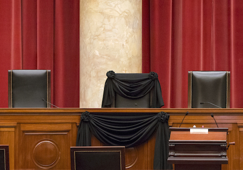 Supreme Court Justice Antonin Scalia's courtroom chair is draped in black to mark his death as part of a tradition that dates to the 19th century / AP