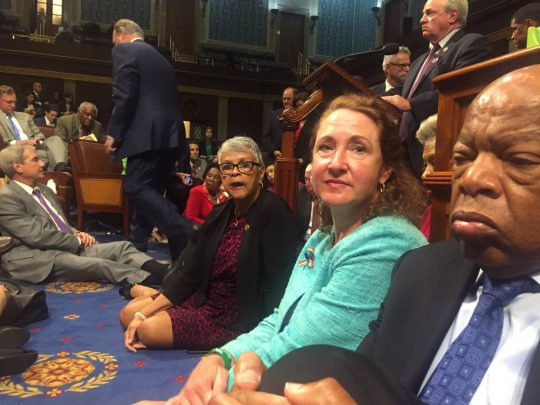 Democrats sitting on the floor