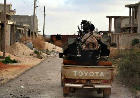 A man loyal to the Libyan armed forces prepares for clashes with Islamic State militants near Sirte, Libya / AP