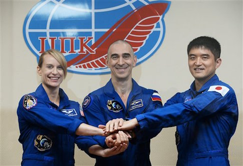 NASA's Kathleen Rubins with astronauts from Russia and Japan / AP