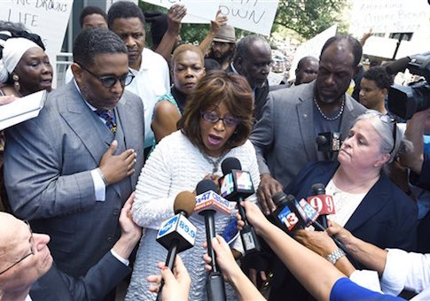 Corrine Brown addresses the media outside the Federal Courthouse on July 8 / AP