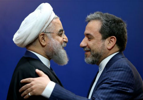 Iran's Deputy Foreign  Minister Abbas Araghchi, right, embraces President Hassan Rouhani / AP
