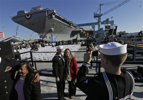 U.S. Navy sailors with family in front of the USS Gerald R. Ford for the christening of the ship in Newport News, Va., Saturday, Nov. 9, 2013 / AP