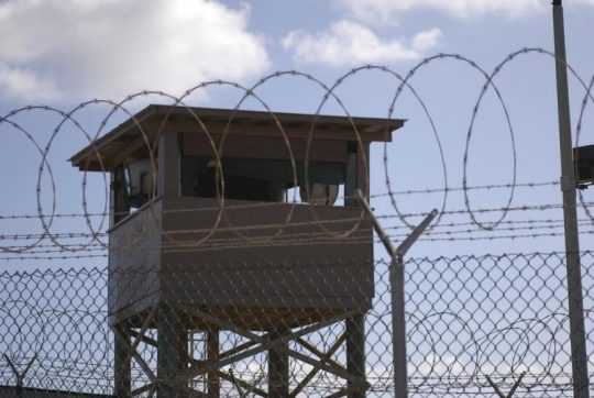 A soldier stands guard in a tower overlooking Camp Delta at Guantanamo Bay naval base in a December 31, 2009, file photo provided by the US Navy. REUTERS / US Navy / Spc. Cody Black