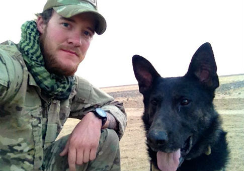 Sgt. Wess Brown with Isky / American Humane Association