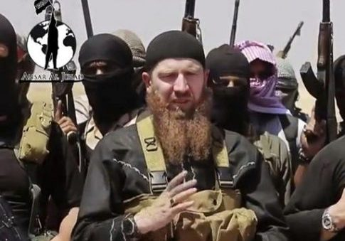 Image from undated video posted during the weekend of June 28, 2014 on a social media account showing Omar al-Shishani standing next to ISIS fighters. AP / militant social media account