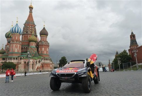 French crew under the number 100 on a Peugeot 2008 Dkr before the start of the 2016 Silk Way Rally on Moscow's Vassilevsky Spusk. Alexey Kudenko / Sputnik via AP