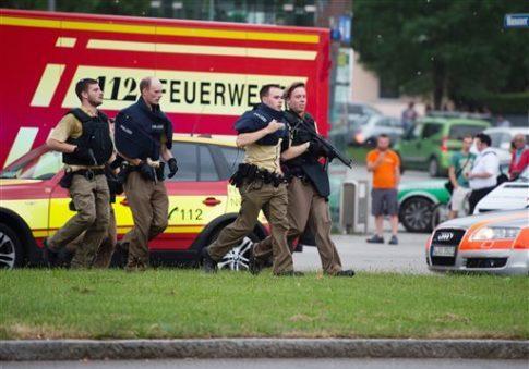 Policemen arrive at Olympia shopping center in Munich, Germany, Friday, July 22, 2016. Matthias Balk / dpa via AP