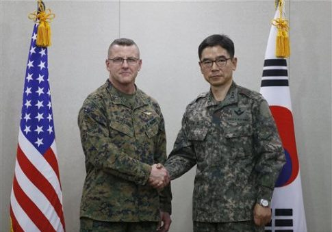 South Korean Defense Ministry Director General Maj. Gen. Jang Kyung-soo, right, and U.S. Forces Korea's Maj. Gen. Robert Hedelund pose for photographers prior to their working-level talk on deploying the THAAD U.S. missile defense system in South Korea, at Defense Ministry in Seoul, South Korea, March 4, 2016. Kim Hong-Ji / Pool Photo via AP