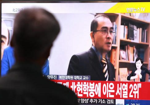 A TV news report airs an image of Thae Yong Ho in South Korea