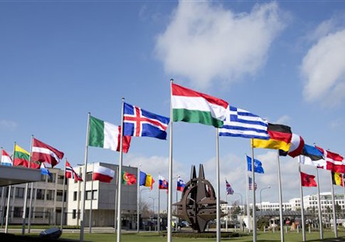 Flags flutter in the wind in front of NATO headquarters in Brussels