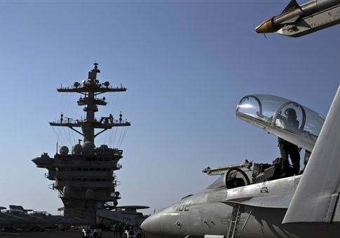 A U.S. Navy fighter jet on the flight deck of the USS Theodore Roosevelt / AP