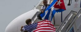 Two passengers deplane from JetBlue flight 387 waving a United States, and Cuban national flag, in Santa Clara, Cuba, Wednesday, Aug. 31, 2016 / AP