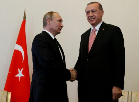 Russian President Vladimir Putin shakes hands with Turkish President Tayyip Erdogan during their meeting in St. Petersburg, Russia, August 9, 2016 / REUTERS