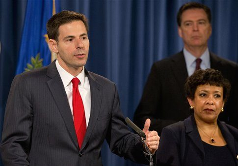 John Carlin, assistant attorney general for national security, left, speaks next to Attorney General Loretta Lynch, and FBI Director James Comey on March 24, 2016 / AP