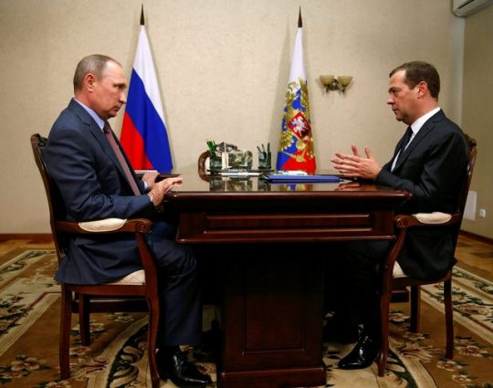 Russian President Vladimir Putin (L) listens to Prime Minister Dmitry Medvedev during their meeting in Crimea, August 19, 2016 / REUTERS
